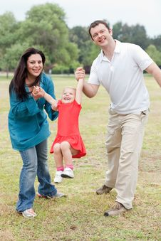Free Lovely Couples Playing With Their Happy Daughter Stock Images - 15752274