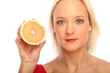 Free Blond Woman With A Grapefruit Stock Photo - 15754370
