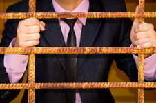 Free Man. Behind An Iron Lattice Royalty Free Stock Photos - 15754938