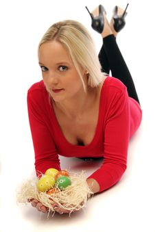 Blond Woman With Easter Eggs Royalty Free Stock Photo