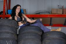 Sexy Young Woman Posing On Tyres Royalty Free Stock Photo