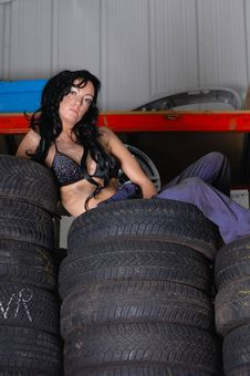 Sexy Young Woman Posing On Tyres Royalty Free Stock Image