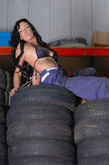 Sexy Young Woman Posing On Tyres Stock Photo