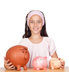 Little Girl With With Three Piggy-bank Royalty Free Stock Photo
