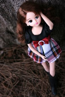 Doll Standing Besides The Tree Stock Photography