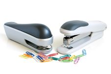 Free Two Staplers And Multicolored Paper Clips Stock Images - 15758904