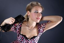 Young Woman With Clutch Bag Stock Photo