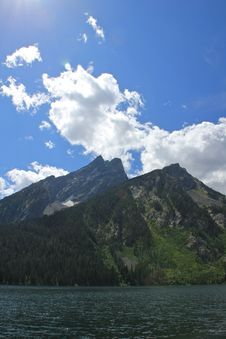 Clouds Hovering Over The Grand Tetons Stock Photo