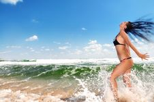 Beautiful Girl Splashing In The Ocean Royalty Free Stock Image