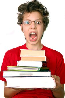Free Shocked Boy With Set Of Books Stock Photo - 15761590