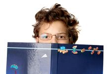 Free Cute Little Boy With A Big Book Stock Photography - 15761622