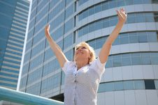 Free Business Woman Standing Against A Background Of Buildings Stock Photo - 15769250