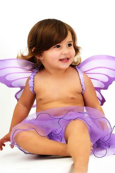 Free Little Girl With Purple Angle Wings Sitting And Smiling Stock Images - 15771214