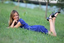 Free WOMAN LAYING ON THE GRASS Royalty Free Stock Photography - 15771227