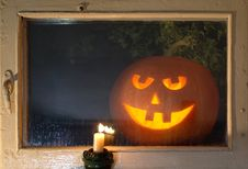 Free Jack O Lantern Behind Window Stock Image - 15772741