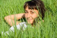 Portrait Of A Smilig Girl In The Grass Royalty Free Stock Image