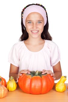 Happy Girl In Halloween With A Many Pumpkins Royalty Free Stock Photo