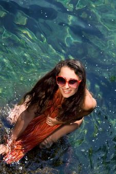 Free Beautiful Young Girl In Red  In The Sea Royalty Free Stock Photos - 15773968