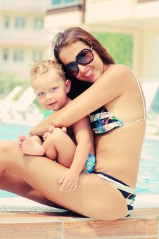 Free Portrait Of Happy Woman And Her Sun In Pool Stock Images - 15774534