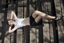 Beautiful Girl Lying On The Stairs Royalty Free Stock Images