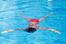Free Girl Floats On Water Royalty Free Stock Photos - 15774968