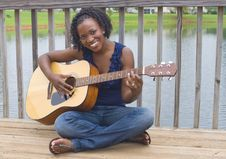 Black Woman With Guitar Royalty Free Stock Photography