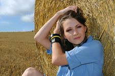 Free Young Woman Near The Straw Bales Stock Photos - 15776343