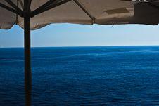 Free Blue Sea Under Beach Umbrella Royalty Free Stock Photo - 15777305