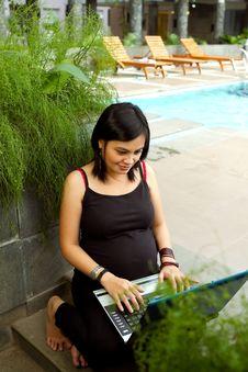 Asian Pregnant Business Woman Working With Laptop Royalty Free Stock Photo