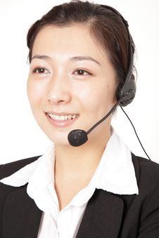 A Smiling Business Woman Talking On The Phone