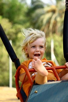 Free Boy On A Swing Stock Photo - 15779590