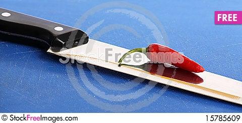 Chili on Knife Stock Photo