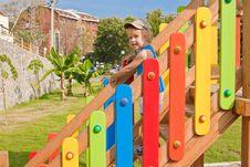 Child On The Playground Stock Photos