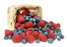 Free Raspberries, Blueberries And Wicker Basket. Royalty Free Stock Images - 15786409