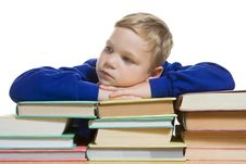 Young Boy With Hands On Top Of Books, Isolated Stock Photo