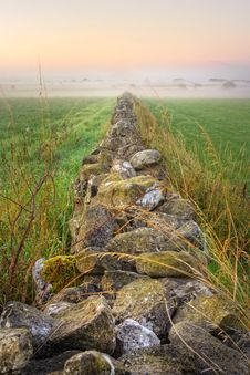 Free Sunrise And Stone Wall Vanishing In Fog, HDR Royalty Free Stock Photo - 15786635