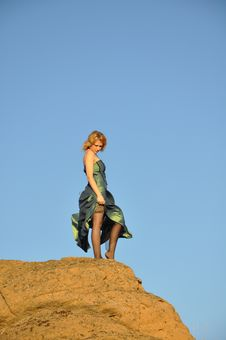 Pretty Woman Atop Of The Cliff Stock Image
