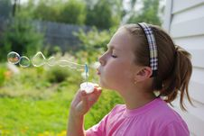 Free Girl Blowing Soap Bubbles Stock Photography - 15788152