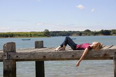 Free Woman Relaxing On Landing Stage Stock Photography - 15789702