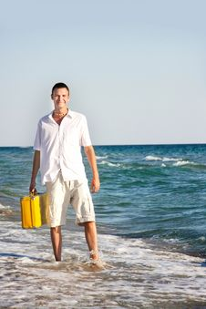 Free Man With Yellow Suitcase On Beach Royalty Free Stock Images - 15790449