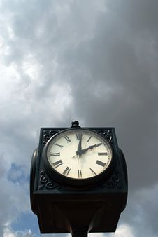 Free Clock Against Moody Sky Stock Image - 15791351