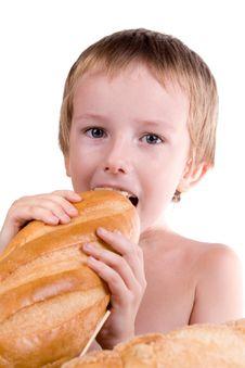 Free Happy Boy Eating Bread Stock Photography - 15792792