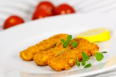 Free Three Fish Fingers And Slice Of Lemon Stock Images - 15799954
