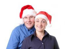 Free Young Couple In Santa Hats Royalty Free Stock Photos - 1582758