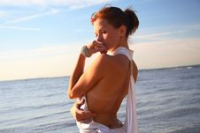 Free Young Female Dressed Up, Standing On A Morning Beach Royalty Free Stock Photography - 1589237