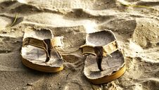 Free Slippers On The Sand Stock Photo - 15800290