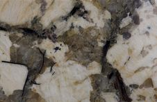 Granite. Pale Yellow And Reddish-brown Shades. Royalty Free Stock Images