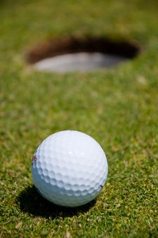 Golf Hole With Ball Stock Images