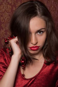 This Is A Beautiful Girl With Red Beads Royalty Free Stock Image