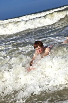 Free Child Has Fun In The Waves Royalty Free Stock Photography - 15810507